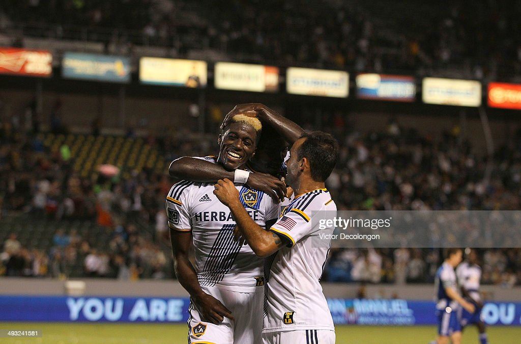 Gyasi Zardes #11 of the Los Angeles Galaxy celebrates his first half goal with teammates Kofi Opare #28 and Juninho #19 during the MLS match against FC Dallas at StubHub Center on May 21, 2014 in Los Angeles, California. The Galaxy defeated FC Dallas 2-1.