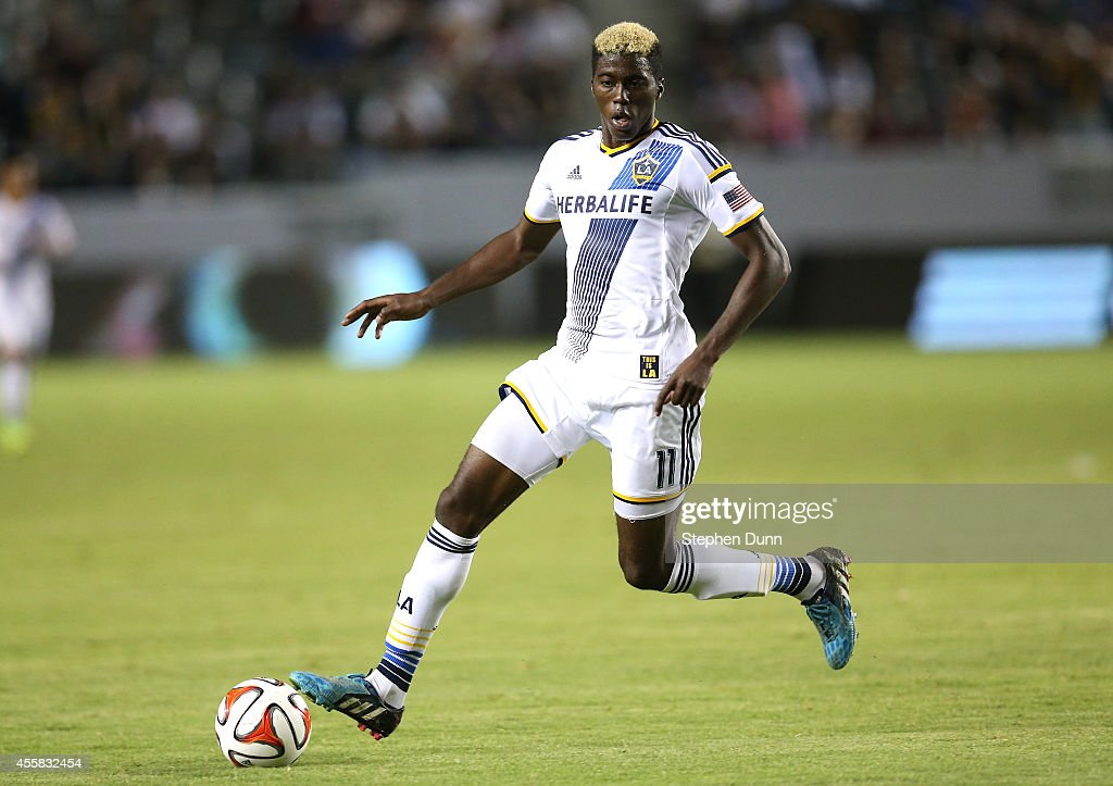 Gyasi Zardes #11 of the Los Angeles Galaxy controls the ball against FC Dallas at StubHub Center on September 20, 2014 in Los Angeles, California.