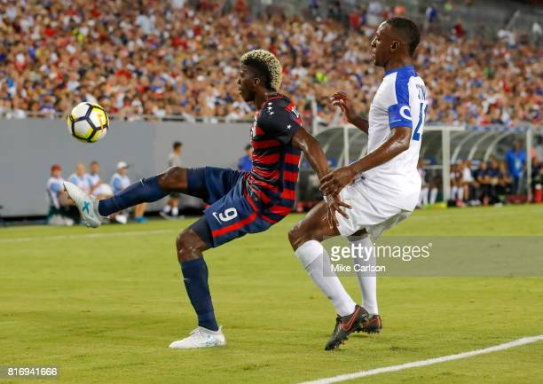 Gyasi Zardes of the United States against Sebastien Cretinoir of Martinique during the first half of the CONCACAF Group B match at Raymond James...