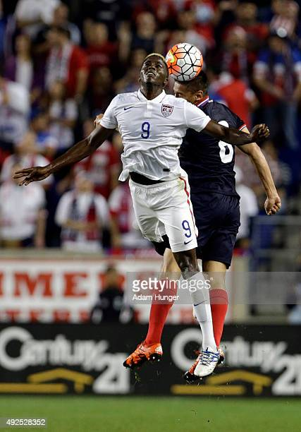Gyasi Zardes of the United States and Oscar Duarte of Costa Rica battle for a header during the first half at Red Bull Arena on October 13 2015 in...