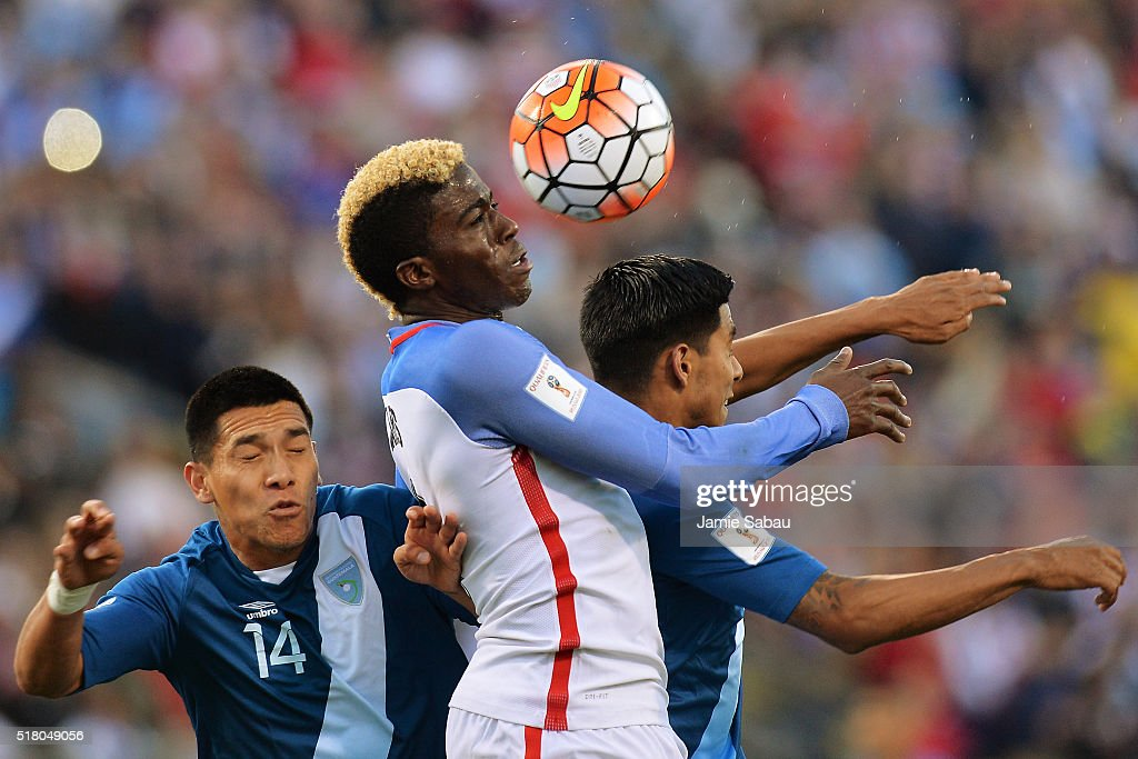 Gyasi Zardes #9 of the United States Men's National Team gets control of the ball around Rafael Morales #14 of Guatemala and Moises Hernandez #5 of Guatemala in the first half to assist on Clint Dempsey #8 of the United States Men's National Team's goal during the FIFA 2018 World Cup qualifier on March 29, 2016 at MAPFRE Stadium in Columbus, Ohio.