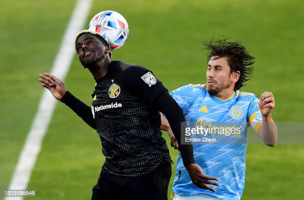 Gyasi Zerdes of Columbus Crew SC and Alejandro Bedoya of Philadelphia Union jump to head the ball in the second half during their game at the...