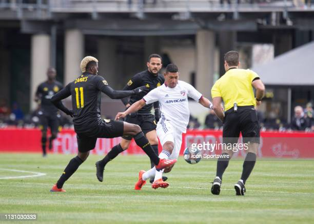 Gyasi Zerdes of Columbus Crew SC and Bryan Acosta of FC Dallas battle for the ball during the match between Columbus Crew SC and FC Dallas at MAPFRE...