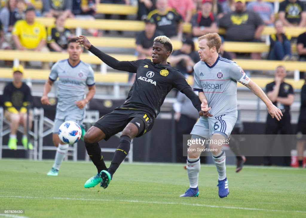 Gyasi Zerdes (11) of Columbus Crew SC and Dax McCarty (6) of Chicago Fire battle for the ball during the game between the Columbus Crew SC and the Chicago Fire at MAPFRE Stadium on May 12, 2018.