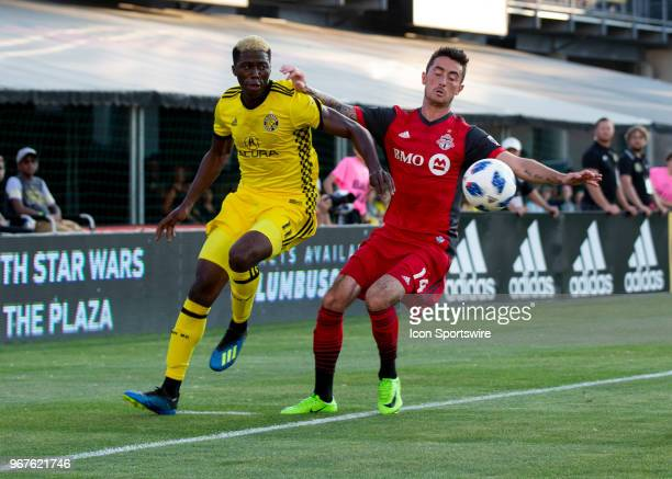 Gyasi Zerdes of Columbus Crew SC and Jay Chapman of Toronto FC battle to keep the ball in bounds during the game between the Columbus Crew SC and the...