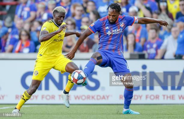 Gyasi Zerdes of Columbus Crew SC and Kendall Waston of FC Cincinnati battle for the ball during the game at Nippert Stadium on August 25, 2019 in...