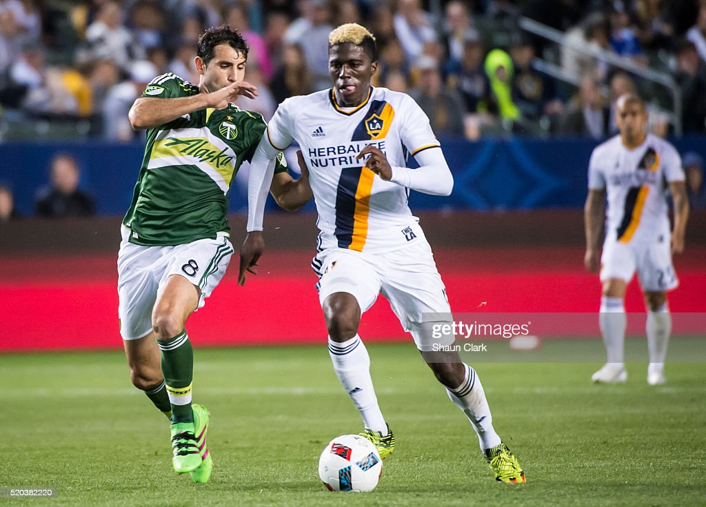 Gyasi Zerdes #11 of Los Angeles Galaxy is chased down by Diego Valeri #8 of Portland Timbers during Los Angeles Galaxy's MLS match against Portland Timbers at the StubHub Center on April 10, 2016 in Carson, California. The match ended in a 1-1 tie