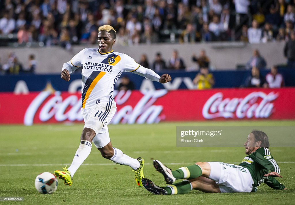 Gyasi Zerdes #11 of Los Angeles Galaxy races past Ned Grabavoy #10 of Portland Timbers during Los Angeles Galaxy's MLS match against Portland Timbers at the StubHub Center on April 10, 2016 in Carson, California. The match ended in a 1-1 tie