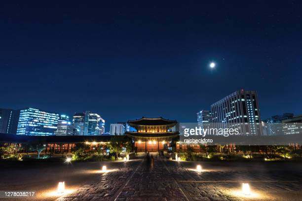 gyeongbokgung palace at night in seoul, south korea - seoul stock pictures, royalty-free photos & images