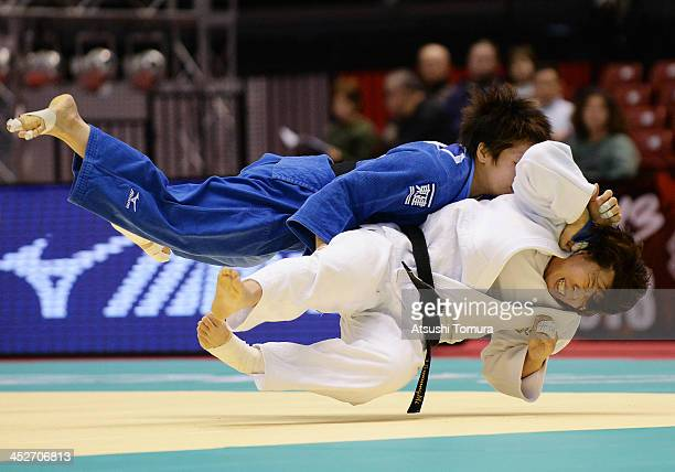GyeongMi Jeong of Korea and Ruika Sato of Japan compete in the women's 78kg semifinal match during day three of the Judo Grand Slam at the on...