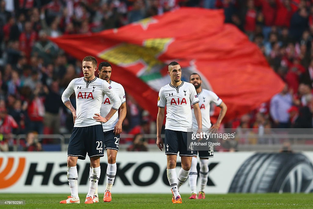 Gylfi Sigurdsson (L) and Nabil Bentaleb (R) of Tottenham Hotspur look dejected after conceding the opening goal during the UEFA Europa League Round of 16 2nd leg match between SL Benfica and Tottenham Hotspur at Estadio da Luz on March 20, 2014 in Lisbon, Portugal.