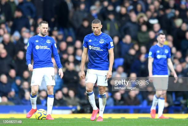 Gylfi Sigurdsson and Richarlison of Everton look dejected after conceding their sides first goal during the Premier League match between Everton FC...