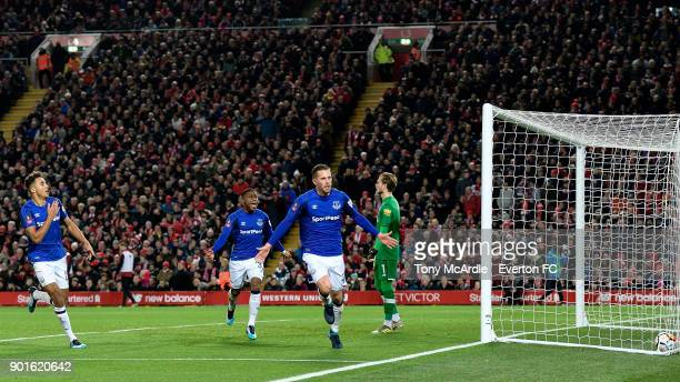 Gylfi Sigurdsson celebrates his goal with Dominic CalvertLewin and Ademola Lookman during The Emirates FA Cup Third Round match between Liverpool and...