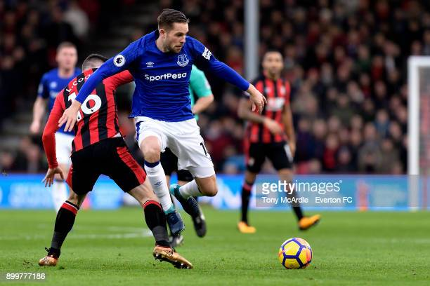 Gylfi Sigurdsson of Everton and Lewis Cook challenge for the ball during the Premier League match between AFC Bournemouth and Everton at the Vitality...