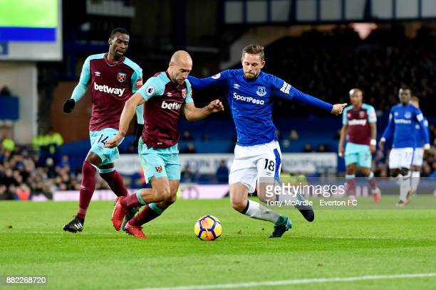 Gylfi Sigurdsson of Everton and Pablo Zabaleta challenge for the ball during the Premier League match between Everton and West Ham United at Goodison...