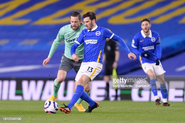 Gylfi Sigurdsson of Everton and Pascal Gross challenge for the ball during the Premier League match between Brighton and Hove Albion and Everton at...
