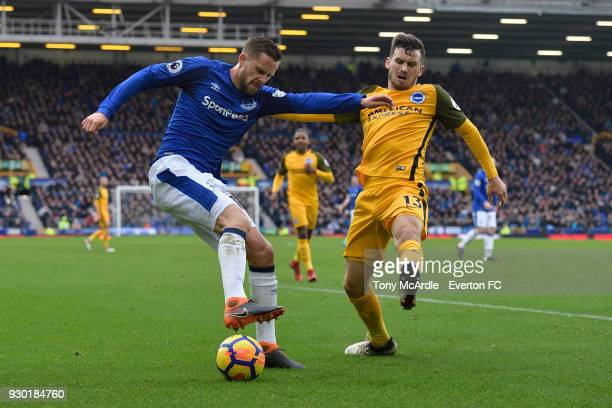 Gylfi Sigurdsson of Everton and Pascal Gross challenge for the ball during the Premier League match between Everton and Brighton and Hove Albion at...