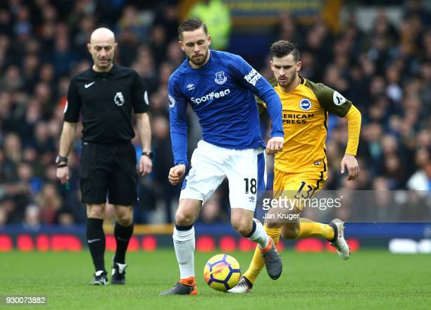 Gylfi Sigurdsson of Everton and Pascal Gross of Brighton and Hove Albion during the Premier League match between Everton and Brighton and Hove Albion...