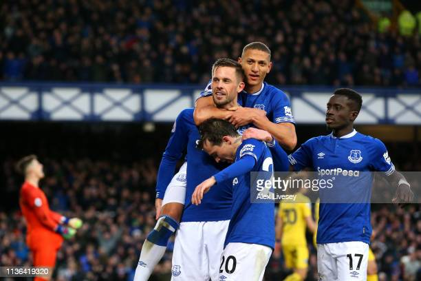 Gylfi Sigurdsson of Everton celebrates after scoring his sides second goal with team mates during the Premier League match between Everton FC and...