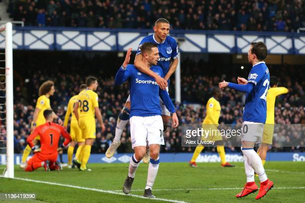 Gylfi Sigurdsson of Everton celebrates after scoring his sides second goal with Richarlison during the Premier League match between Everton FC and...