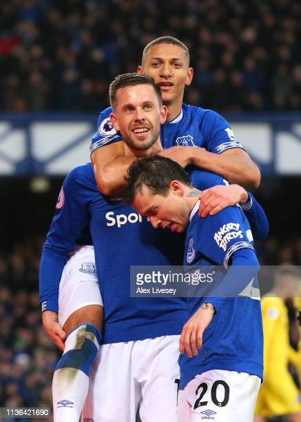 Gylfi Sigurdsson of Everton celebrates after scoring his sides second goal with teammates during the Premier League match between Everton FC and...