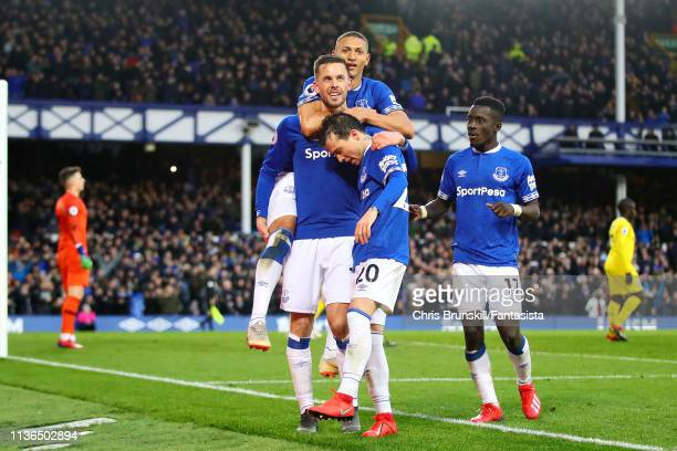 Gylfi Sigurdsson of Everton celebrates after scoring his sides second gozl during the Premier League match between Everton FC and Chelsea FC at...
