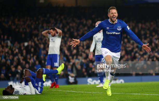 Gylfi Sigurdsson of Everton celebrates after scoring his team's first goal during the Premier League match between Everton FC and Cardiff City at...