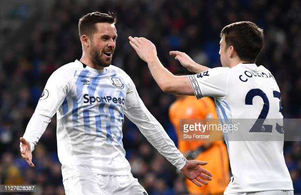 Gylfi Sigurdsson of Everton celebrates after scoring his team's first goal with Seamus Coleman during the Premier League match between Cardiff City...