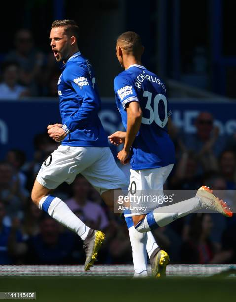 Gylfi Sigurdsson of Everton celebrates after scoring his team's second goal with Richarlison during the Premier League match between Everton FC and...