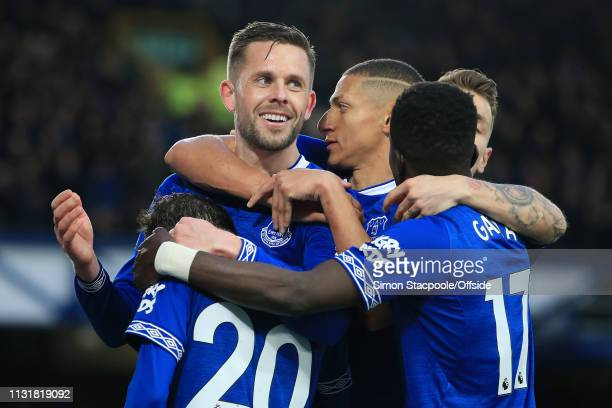 Gylfi Sigurdsson of Everton celebrates after scoring their 2nd goal during the Premier League match between Everton and Chelsea at Goodison Park on...