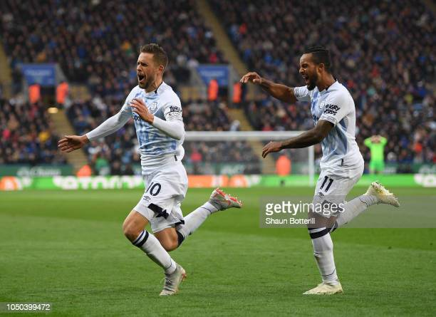 Gylfi Sigurdsson of Everton celebrates after scoring with team-mate Theo Walcott during the Premier League match between Leicester City and Everton...
