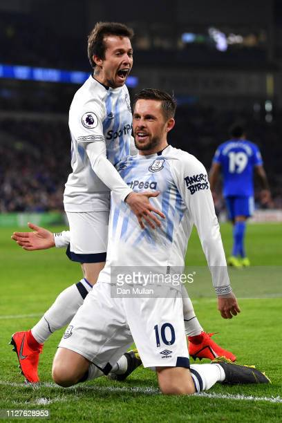 Gylfi Sigurdsson of Everton celebrates as he scores his team's second goal with Bernard during the Premier League match between Cardiff City and...