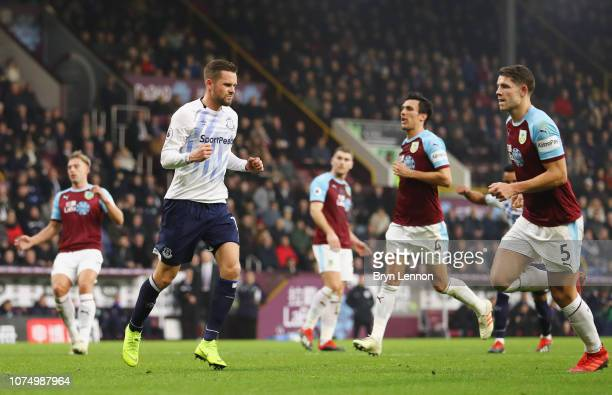 Gylfi Sigurdsson of Everton celebrates as he scores his team's third goal from a penalty during the Premier League match between Burnley FC and...