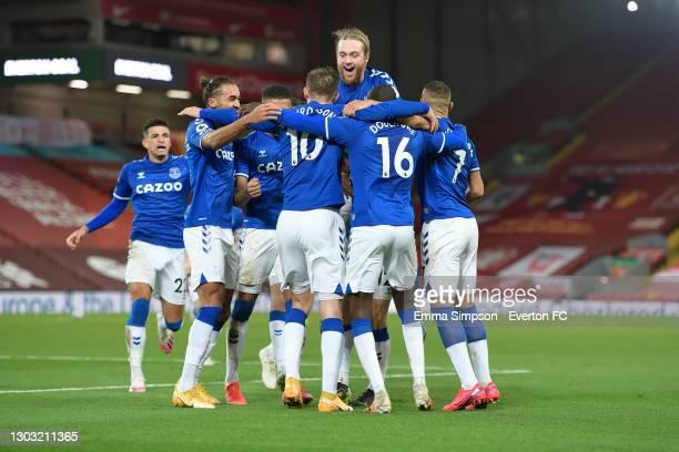 Gylfi Sigurdsson of Everton celebrates his goal with Ben Godfrey Dominic Calvert-Lewin Tom Davies and team mates during the Premier League match...