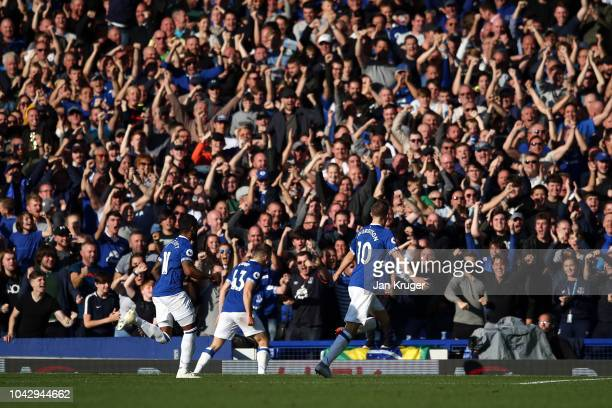Gylfi Sigurdsson of Everton celebrates scoring his opening goal during the Premier League match between Everton FC and Fulham FC at Goodison Park on...