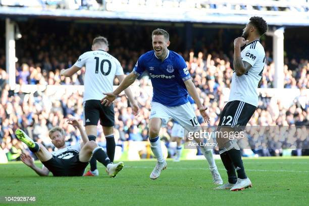 Gylfi Sigurdsson of Everton celebrates scoring his sides third goal and his second during the Premier League match between Everton FC and Fulham FC...