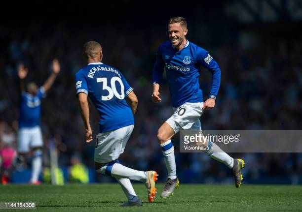 Gylfi Sigurdsson of Everton celebrates scoring the second goal with team mate Richarlison during the Premier League match between Everton FC and...