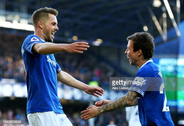Gylfi Sigurdsson of Everton celebrates with Bernard of Everton after scoring his sides third goal and his second during the Premier League match...
