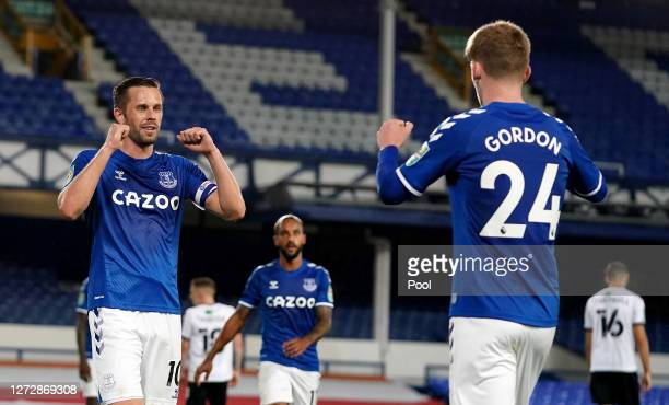 Gylfi Sigurdsson of Everton celebrates with teammate Anthony Gordon after scoring his team's second goal during the Carabao Cup Second Round match...
