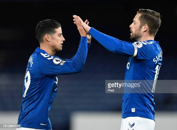 Gylfi Sigurdsson of Everton celebrates with teammate James Rodriguez after scoring their team's first goal from the penalty spot during the Premier...