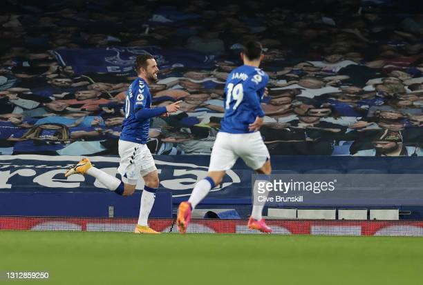 Gylfi Sigurdsson of Everton celebrates with teammate James Rodriguez after scoring their team's second goal during the Premier League match between...