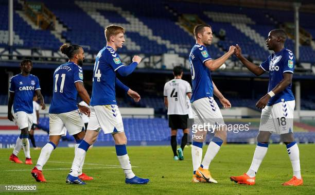 Gylfi Sigurdsson of Everton celebrates with teammate Niels Nkounkou after scoring his team's second goal during the Carabao Cup Second Round match...