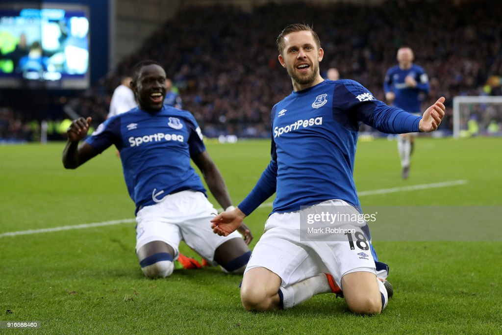 Gylfi Sigurdsson of Everton celebrates with teammate Oumar Niasse after scoring his sides first goal during the Premier League match between Everton and Crystal Palace at Goodison Park on February 10, 2018 in Liverpool, England.
