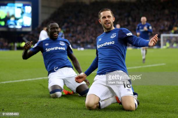 Gylfi Sigurdsson of Everton celebrates with teammate Oumar Niasse after scoring his sides first goal during the Premier League match between Everton...