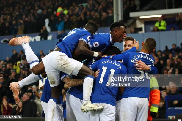 Gylfi Sigurdsson of Everton celebrates with teammates after scoring his team's first goal during the Premier League match between Everton FC and...