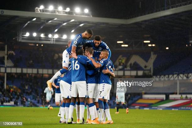 Gylfi Sigurdsson of Everton celebrates with teammates after scoring their team's first goal from the penalty spot during the Premier League match...