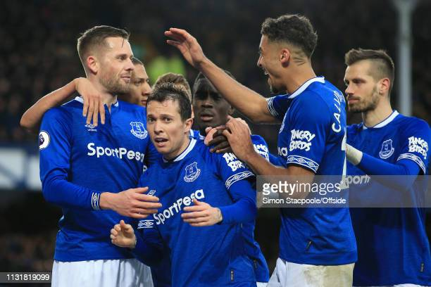 Gylfi Sigurdsson of Everton celebrates with teammates Bernard of Everton and Dominic CalvertLewin of Everton after scoring their 2nd goal during the...