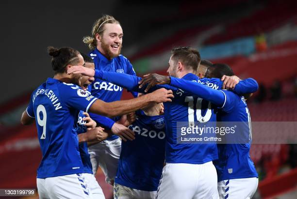 Gylfi Sigurdsson of Everton celebrates with teammates Dominic Calvert-Lewin, Tom Davies, and Abdoulaye Doucoure after scoring his team's second goal...