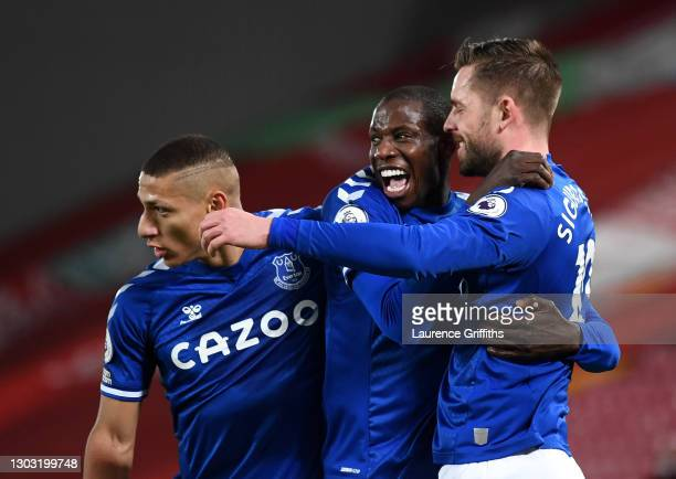 Gylfi Sigurdsson of Everton celebrates with teammates Richarlison and Abdoulaye Doucoure after scoring his team's second goal during the Premier...