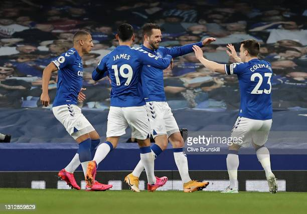Gylfi Sigurdsson of Everton celebrates with teammates Seamus Coleman and James Rodriguez after scoring their team's second goal during the Premier...
